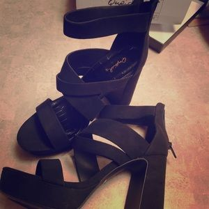Black block heel with toes out